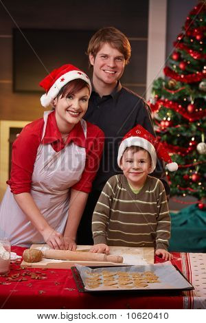Happy Family Baking Christmas Cake Together