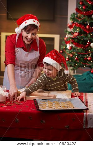 Mother And Son Making Christmas Cake