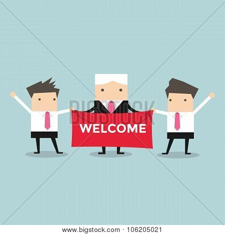Businessman holding welcome sign