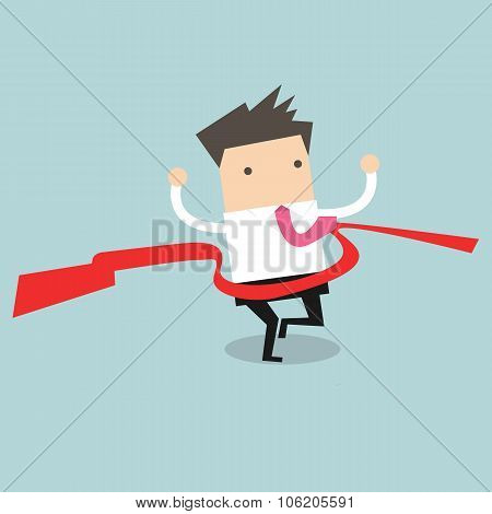 Businessman crossing finish line, he is won a competition