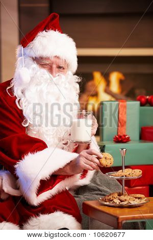 Santa Drinking Milk Eating Chocolate Chip Cookies