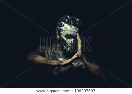 Culture, wild man with white painted face and full body black paint