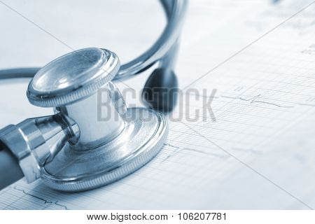 Stethoscope And Cardiogram On The Form