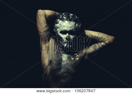 Dance, wild man with white painted face and full body black paint