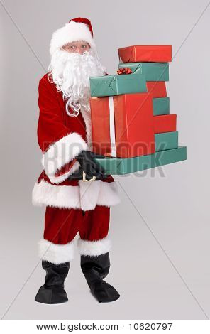 Santa Lifting Christmas Presents