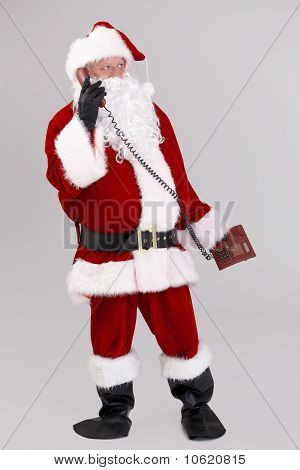 Full Size Photo Of Santa Talking On Phone