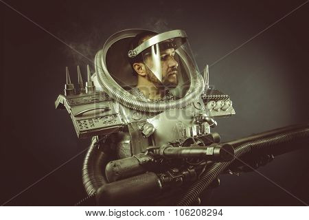 Astronomy, spaceman with plasma gun and helmet glass