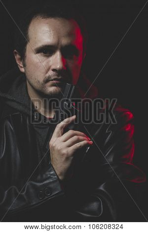 Shoot, Man with intent to commit suicide, gun and leather jacket, red backlight