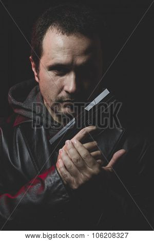 Sadness, Man with intent to commit suicide, gun and leather jacket, red backlight