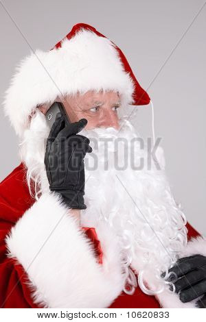 Isolated Portrait Of Santa Claus On The Phone