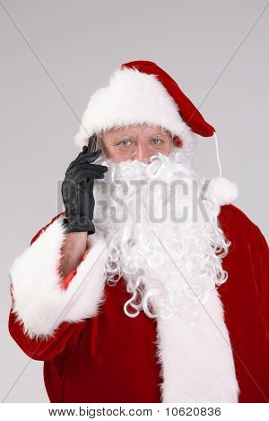 Portrait Of Santa Claus On The Phone