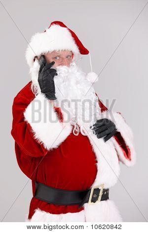 Santa Talking On Mobile Looking At Camera