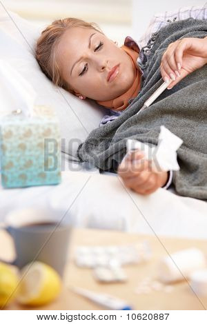 Young Female Caught Cold Laying In Bed