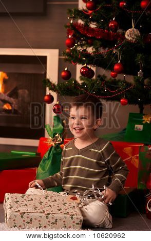 Happy Kid With Christmas Present