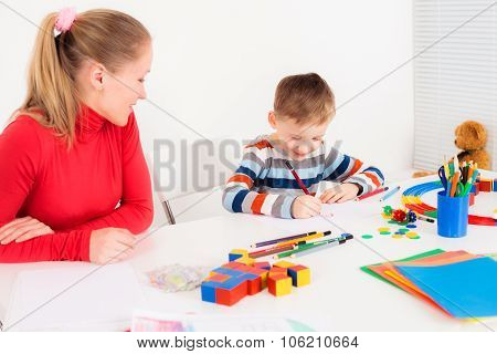 Mother looking at her drawing son