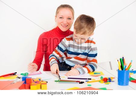 Woman with child drawing picture