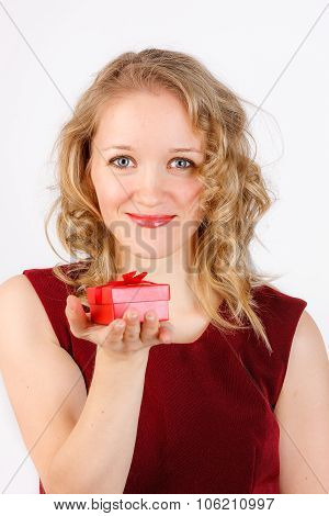 Close up of beautiful woman holding red gift box in her hand