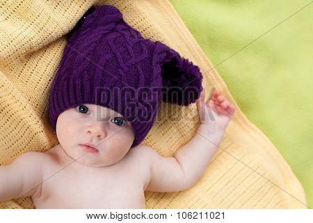 Cute little boy in purple hat
