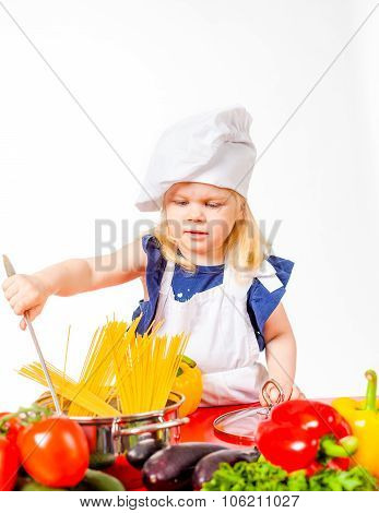 Little girl and pan with pasta