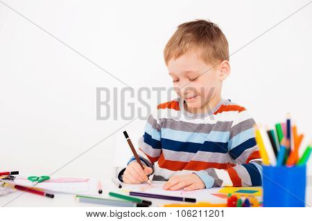 A little boy is happy to draw picture