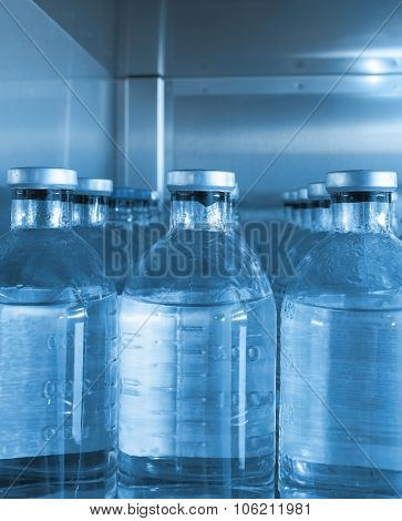 Series Of Bottles With A Solution In The Repository