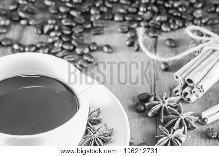 Coffee On The Cup With Coffee Beans And Cinnamon Sticks On Black And White , Selective Focus