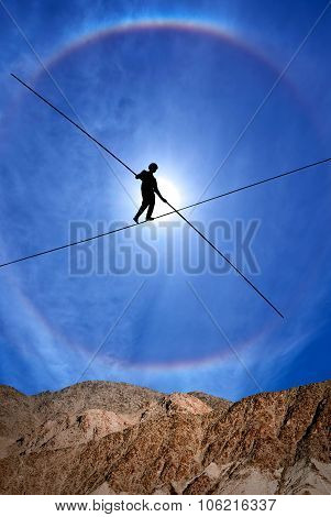 Tightrope Walker Balancing On The Rope Vertical Image