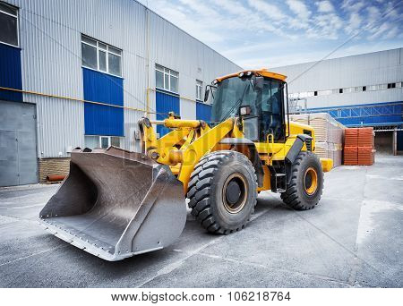 Yellow tractor with bucket