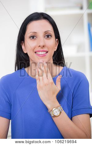 Beautiful smiling deaf woman using sign language