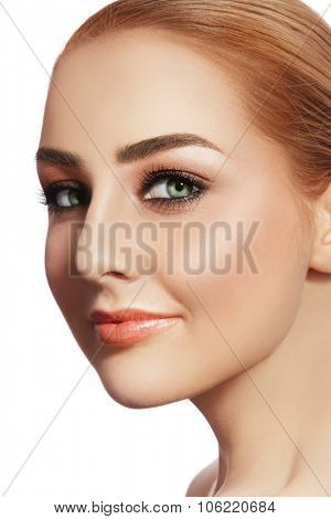 Close-up portrait of young beautiful healthy smiling woman with stylish make-up over white background, copy space