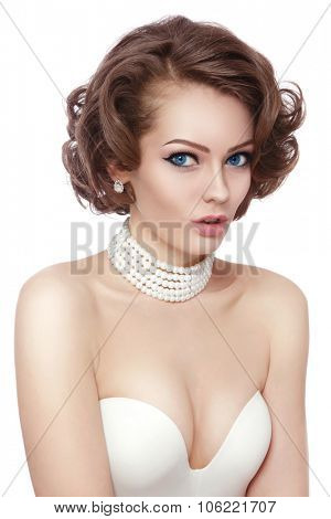 Young beautiful sexy woman with stylish curly hairdo and surprised expression over white background