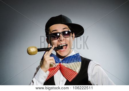 Funny man with mic in karaoke concept