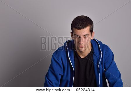 Thinker Attractive Young Man In A Blue Hoodie