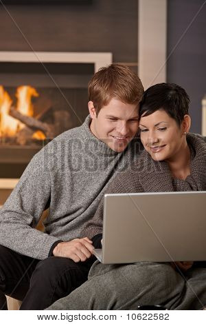 Couple Using Laptop At Winter
