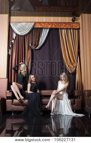luxury girls in evening dresses. beautiful settings