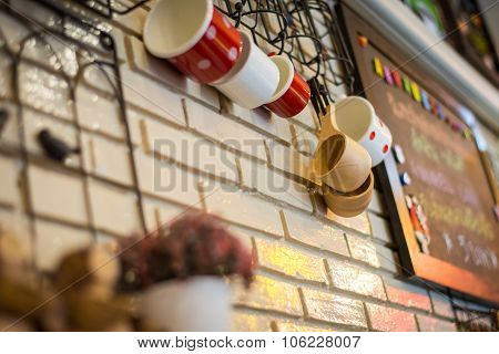 Cup Wooden Decorated In Coffee Cafe With Brick Wall