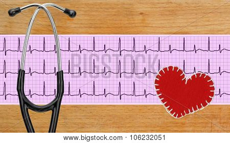 Stethoscope, Electrocardiogram Graph (ecg) And Textile Heart Over Wooden Background