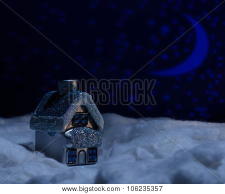 Toy House Stands In Snow During The Night Of Wool