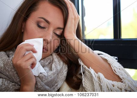 Flu. Closeup image of frustrated sick woman