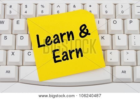 Learn And Earn, Computer Keyboard And Sticky Note