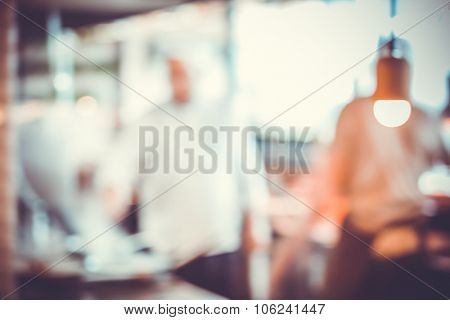 abstract Blurred background with kitchen interior and light bulb