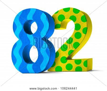 Colorful Paper Mache Number On A White Background  - Number 82