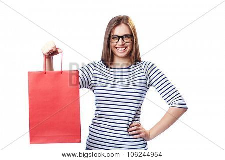 Happy customer with red paperbag looking at camera