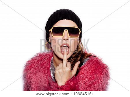 Young Woman Kissing Middle Finger On White Background