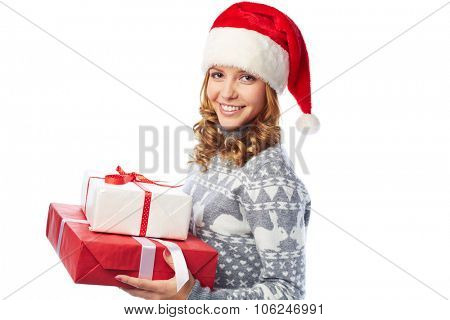 Smiling girl holding giftboxes with Christmas surprises