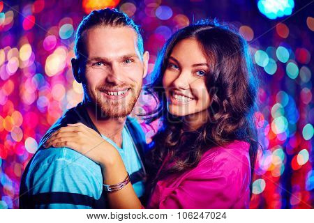 Couple of romantic guy and girl enjoying night clubbing