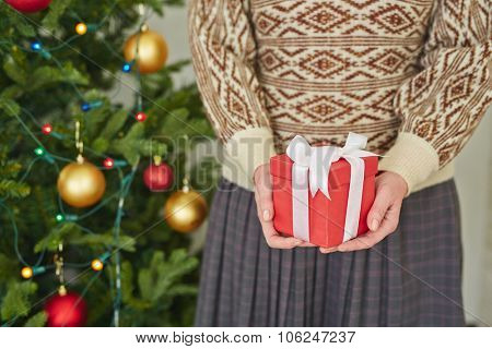 Woman holding a gift box in hands