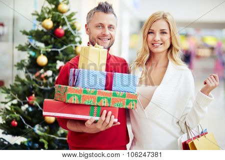 Portrait of a couple with Christmas presents