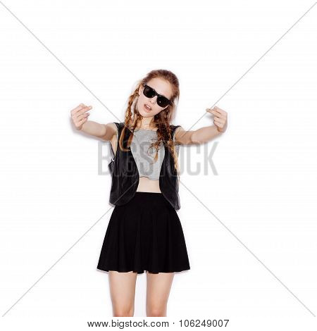Teen Girl In Sunglasses Showing Middle Fingers