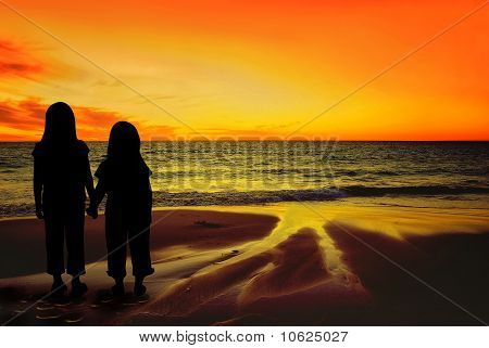 Children watching the sunset